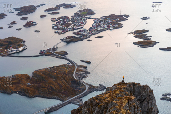 Norway- Lofoten Islands- Henningsvaer- man standing on viewing point with raising arms