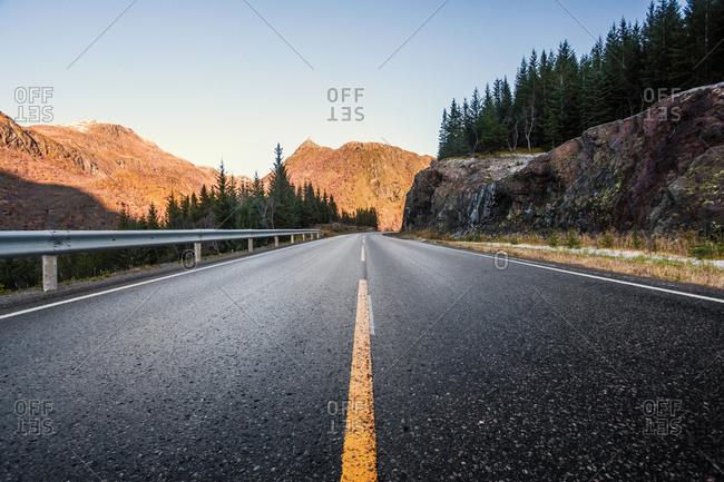 Norway- Lofoten Islands- empty road and rock face