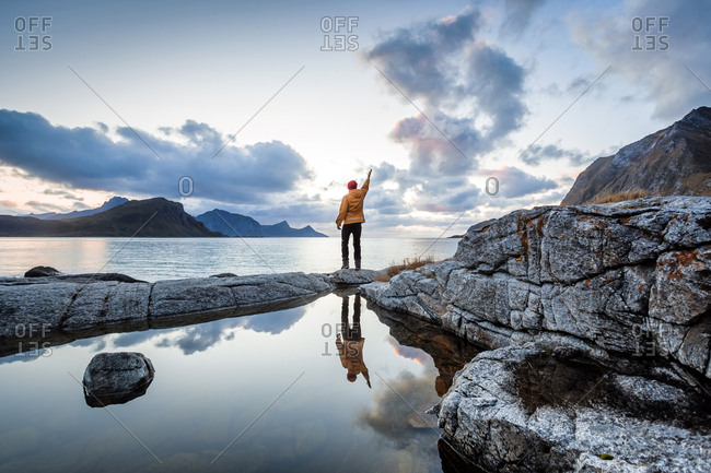 Norway- Lofoten Islands- Haukland Beach- hiker with raised arm