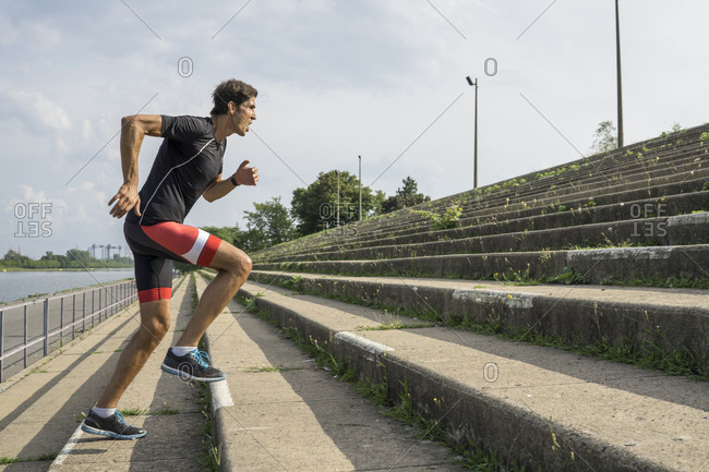 Male athlete climbing stairs intensely training for triathlon
