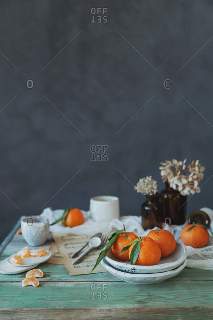 A fresh breakfast with clementines on a green wood table