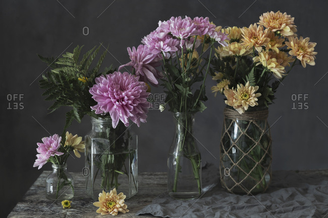 Purple and yellow flowers on vases