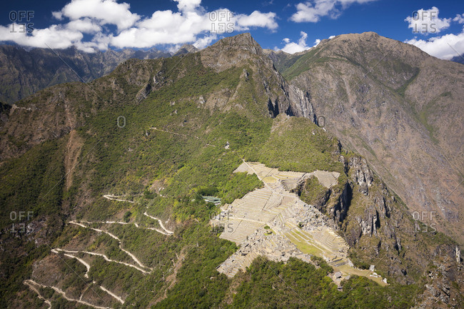 A birds eye view of the ancient Inca site of Machu,  Picchu,  Peru