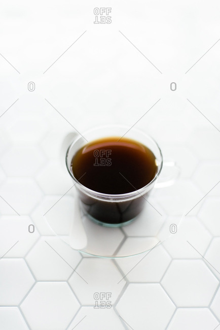 Minimal coffee on white tile