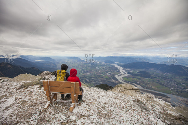 Father and son view the Fraser valley for the summit of Mt Cheam.