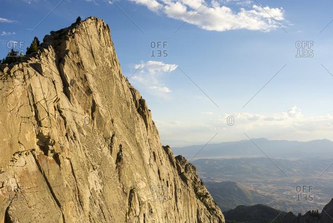 A father and son rock climbing near Lone Peak,  Utah