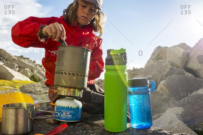 A boy camping in lone Peak Cirque,  Utah