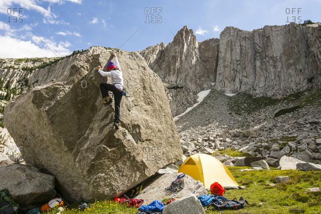 A boy rock climbing below Lone Peak,  Utah