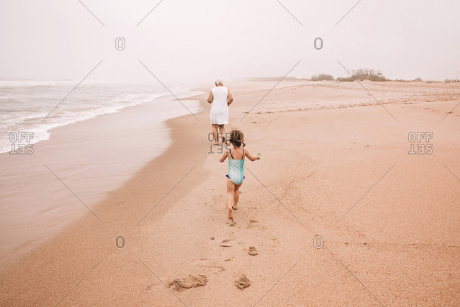 Chasing great grandma on the beach