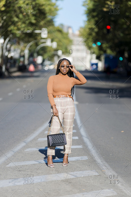 Black woman walking on the road