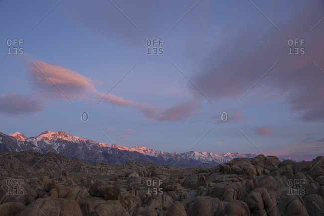 Landscape of the rocky desert meeting snowcapped mountains