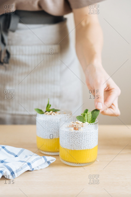 Person adding mint to smoothie