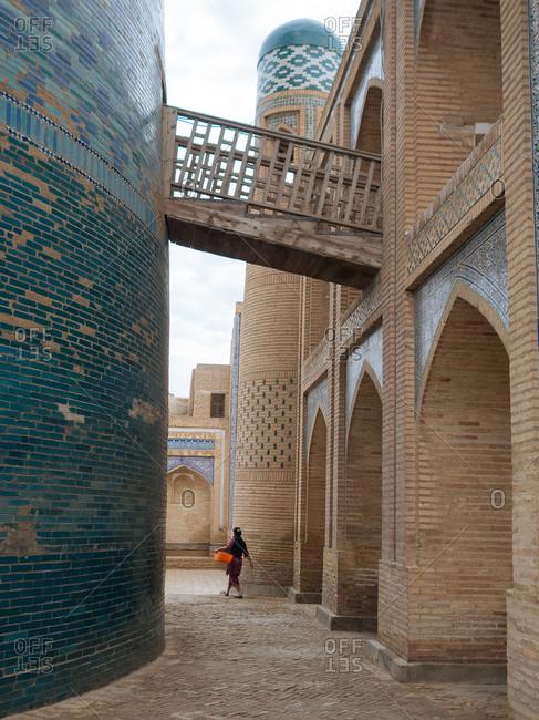 Woman walking on streets of city in Uzbekistan