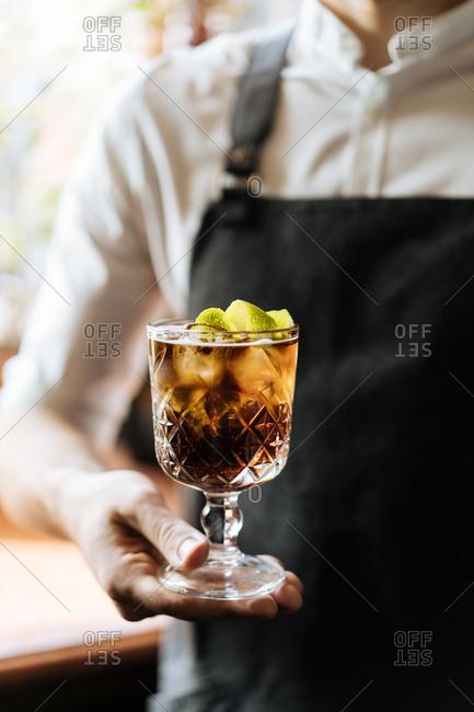 Bartender holding freshly made cocktail
