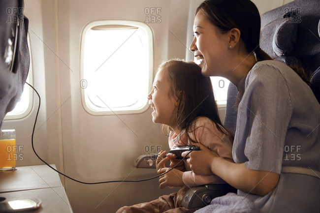 Happy family travel by plane