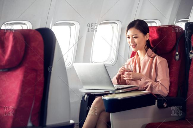Business women by plane
