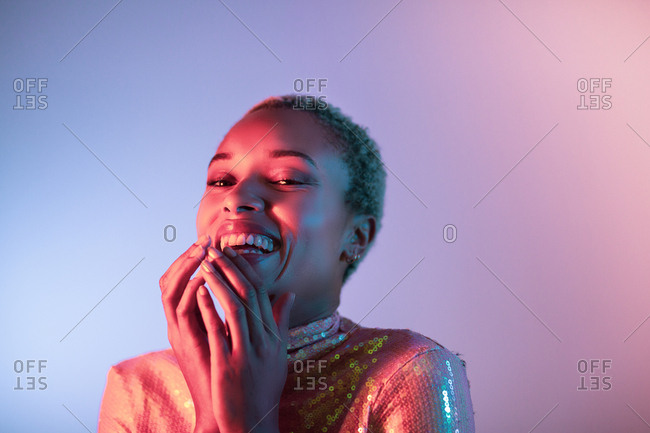 Creative shot of young adult female laughing