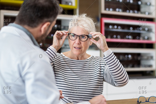 Customer trying frames at the opticians