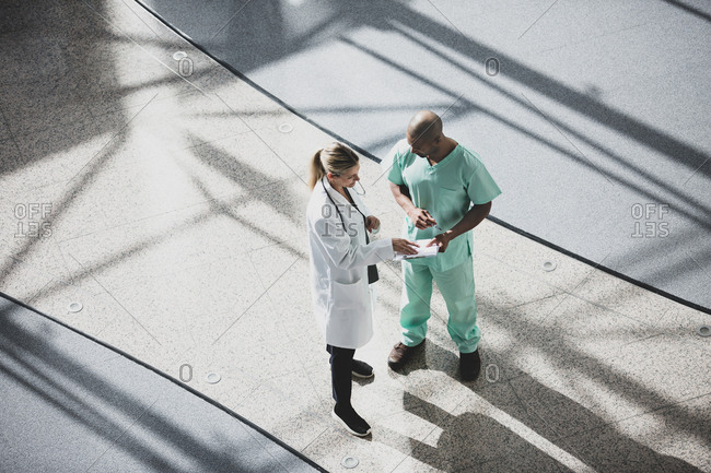Overhead shot of medical professionals discussing results in a hospital