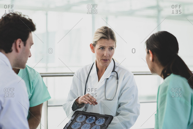 Medical professionals discussing results in a hospital