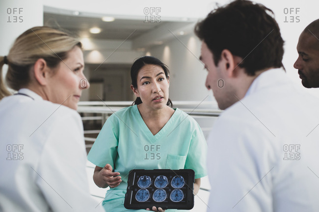 Female hispanic surgeon discussing results in a hospital