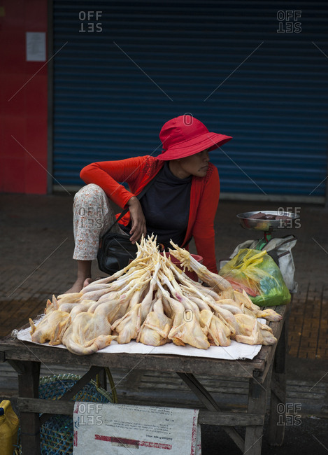 Cambodia - July 29, 2013: Woman selling chickens at the russian market in phnom penh