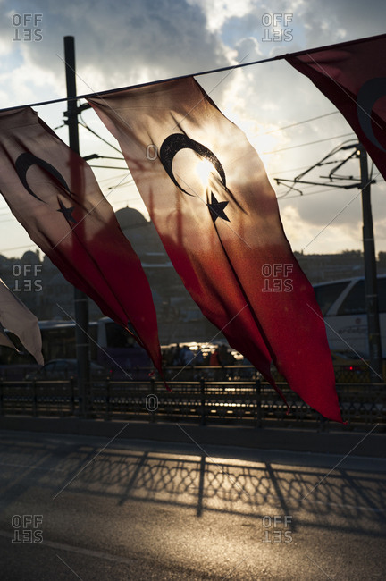 Turkish flags backlit on the galata bridge in istanbul