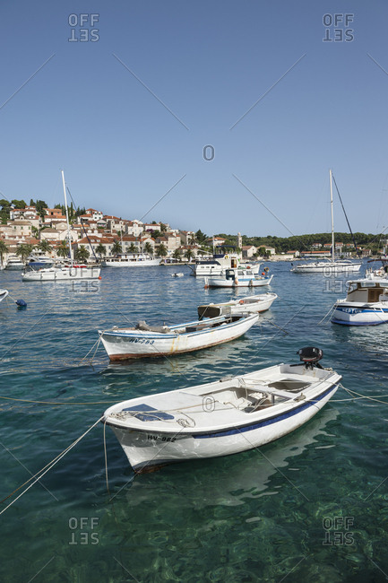 Croatia - July 5, 2014: Hvar port with fishing boats and yachts on a sunny summer morning