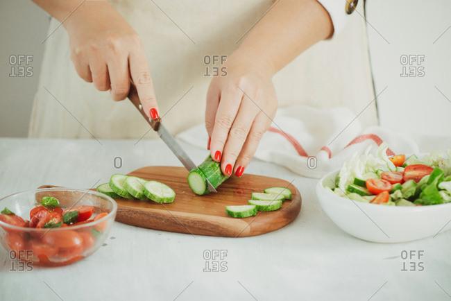 Healthy lifestyle, diet concept. Making fresh green salad