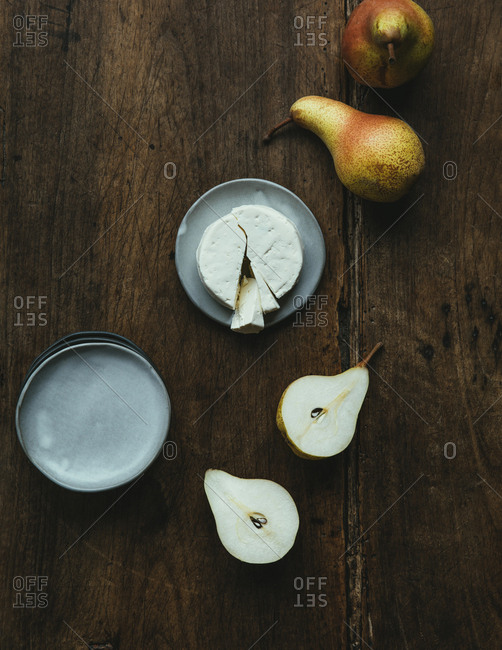 Cheese and pears on wooden table