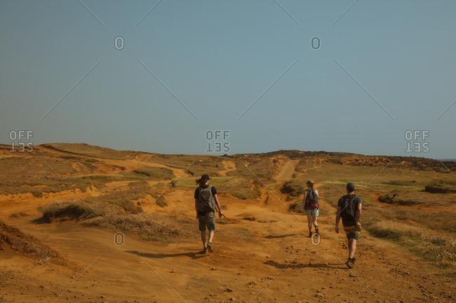 Tourists hiking through sandy landscape