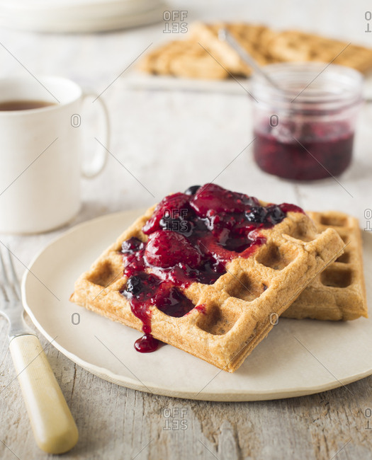 Wholesome waffles topped with strawberry and blueberry jam