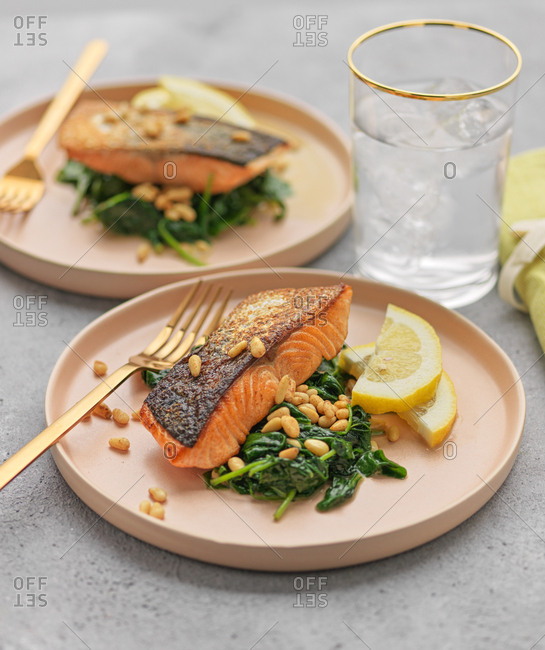 Pan roasted salmon with wilted baby spinach and toasted pinenuts