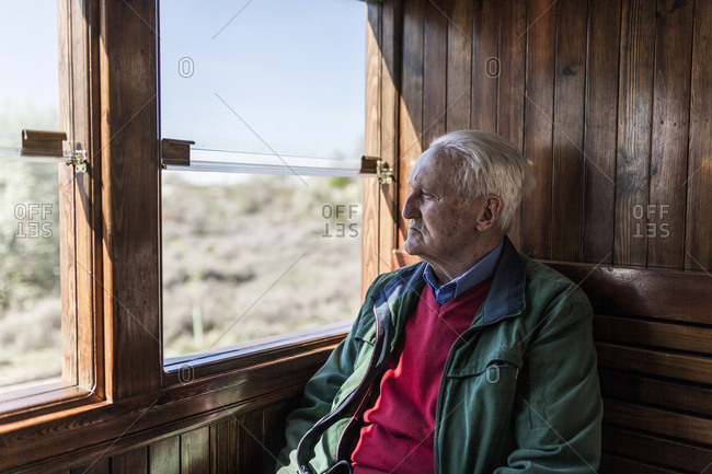 Journey to the memory of an old man travelling in the train of his youth, looking out the window