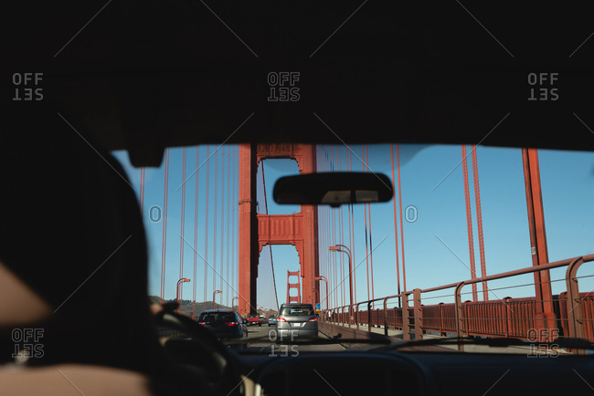 View from inside the car of golden gate bridge on sunny day