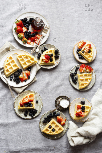 Gluten-free Paleo Waffle with Berries and Maple Syrup.