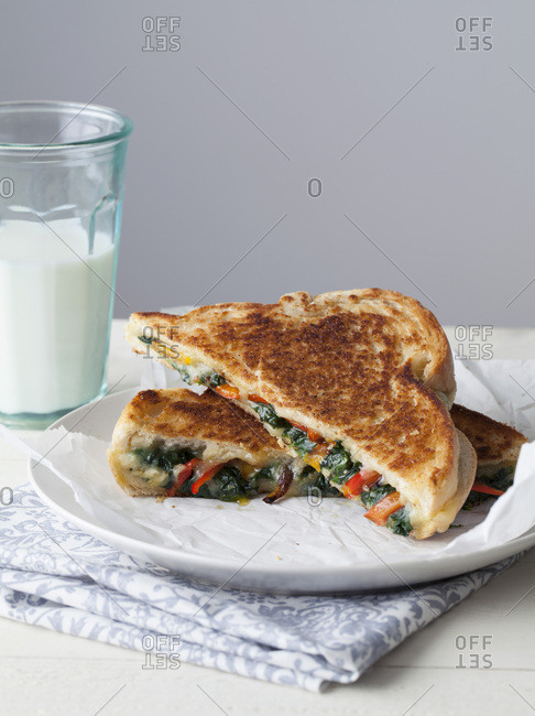 Cheese and Vegetable Toasted Sandwich with Glass of Milk