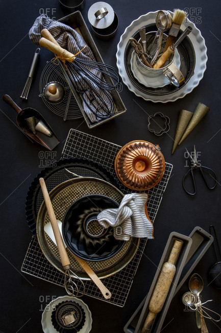 Baking and patisserie equipment over black background