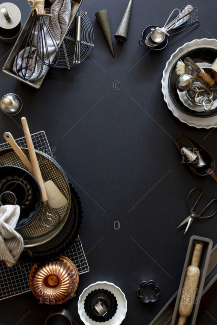 Baking and patisserie equipment over black background with copy space