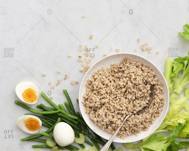 Ingredients for a bean, barley and egg salad, with copy space.