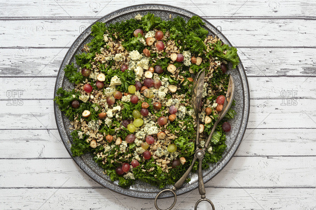 Kale salad with mixed grains, nuts and grapes.