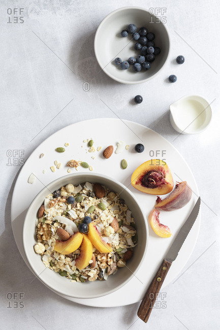 Ingredients prepared for a healthy breakfast of fresh fruit, nuts and muesli.