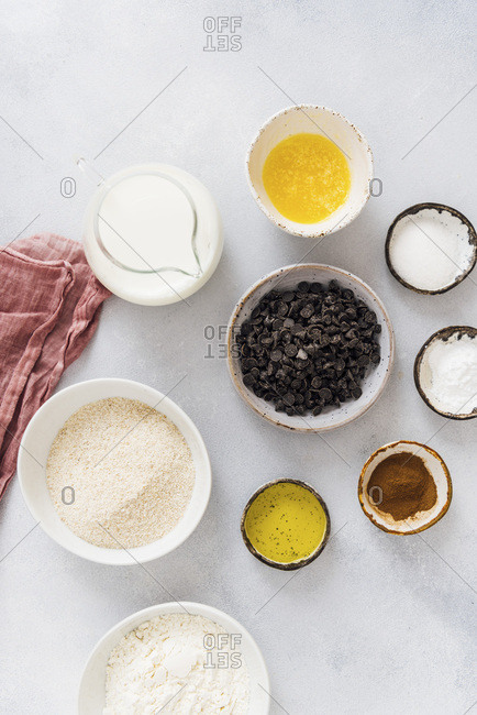 Ingredients for egg free pancakes ready on a grey background.