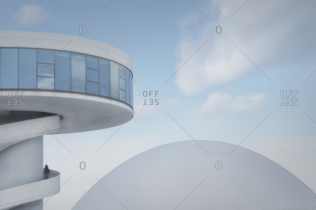 May 6, 2019: Modern white urban tower with spiral staircase and laconic dome on clear blue sky background, Aviles, Asturias, Spain