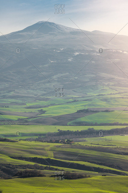 March 22, 2018: Majestic landscape of green valley with fields and mountain range in Tuscany, Italy