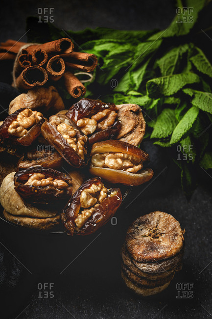 Dates fruits and dried figs with walnuts, mint and cinnamon Muslim halal for Ramadan