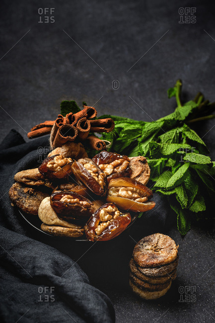 Dates fruits with and dried figs , mint and cinnamon Muslim halal snack for Ramadan