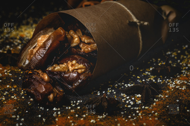Dates fruits with walnuts and cinnamon wrapped in paper for Ramadan