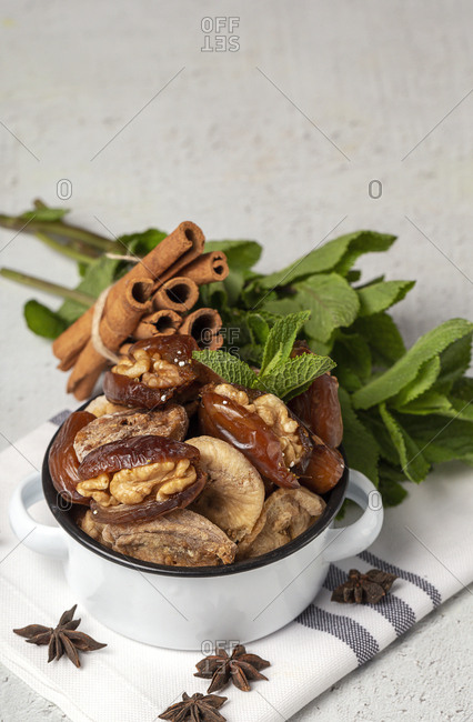 Dates fruits with walnut sand dried figs, mint and cinnamon Muslim halal snack for Ramadan