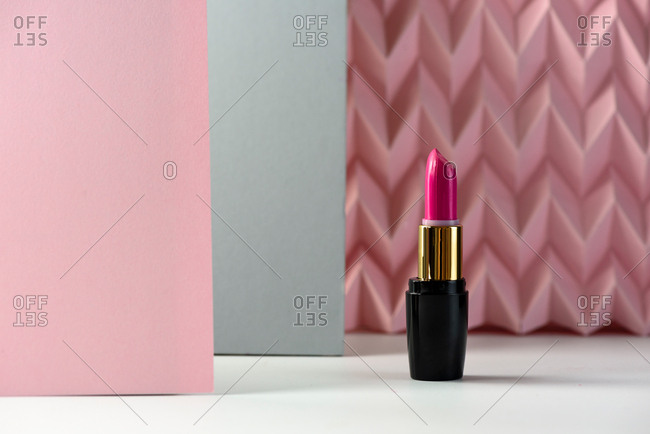 Lipstick on raised pink chevron. Product and make up concept